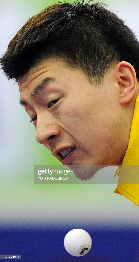 Ma Long of China services to Vladimir Samsonov of Belarus during the men's quarter final at the 2010 World Team Table Tennis Championships in Moscow on May 28, 2010.