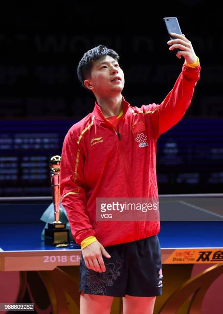 Ma Long of China takes selfie during awarding ceremony after winning men's singles final match against Fan Zhendong of China on day four of the 2018...