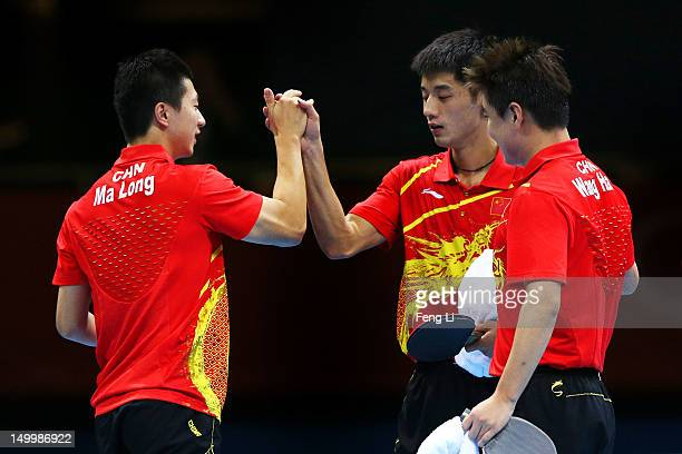 Ma Long Wang Hao and Zhang Jike of China celebrate defeating Korea to win the Men's Team Table Tennis gold medal match on Day 12 of the London 2012...