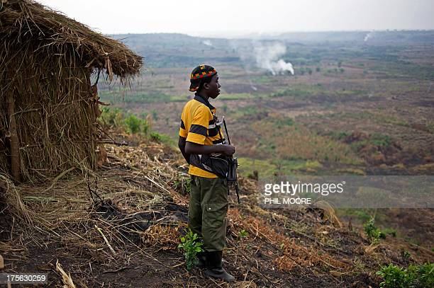 A Maï Maï Nyatura fighter stands at a hilltop base in Kiseguro around 90km north of Goma in the east of the Democratic Republic of the Congo in this...