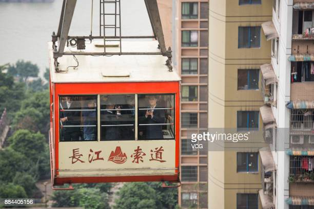 Ma ''Pony'' Huateng chairman and chief executive officer of Tencent Holdings Ltd takes a Yangtze River Cableway cable car after scanning a QR code...