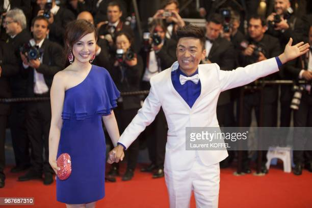 Ma Rong and actor Baoqiang Wang attend the Premiere of 'Tian Zhu Ding' during The 66th Annual Cannes Film Festival at Palais des Festivals on May 17...