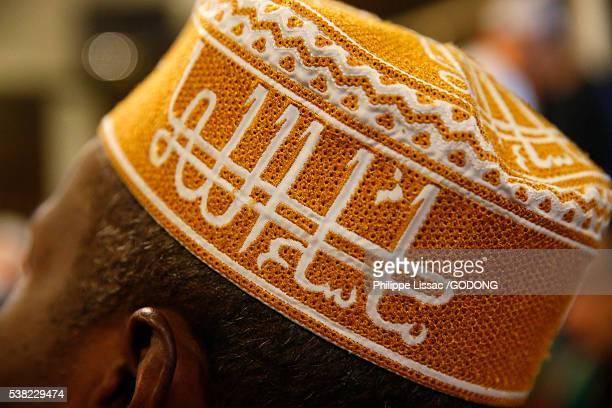 Ma Sha Allah calligraphy on a muslim's hat. (God's will be done).