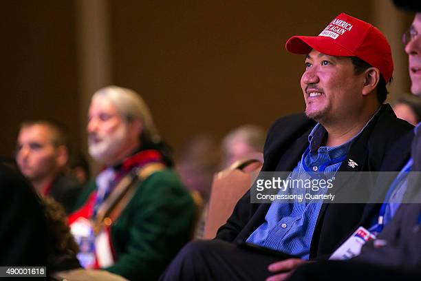 A ma wears a Trump 2016 hat as Republican presidential candidate Donald Trump speaks at the Values Voters Summit at the Omni Shoreham hotel in...