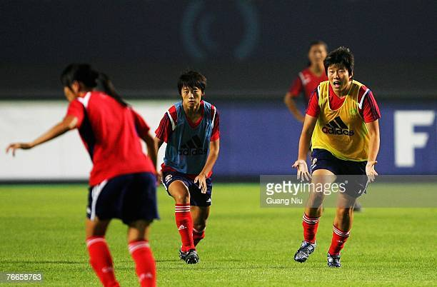 Ma Xiaoxu of China asks a ball during a training session for the FIFA 2007 World Cup in China at Wuhan Sports Center Stadium on September 11, 2007 in...