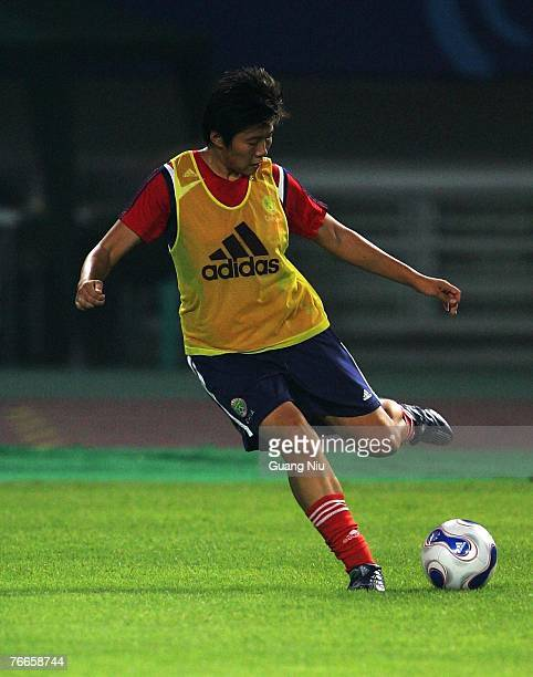 Ma Xiaoxu of China attends a training session for the FIFA 2007 World Cup in China at Wuhan Sports Center Stadium on September 11, 2007 in Wuhan,...