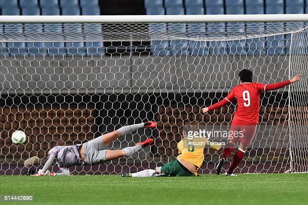 Ma Xiaoxu of China heads the ball past Mackenzie Arnold of Australia to score her team's first goal during the AFC Women's Olympic Final...