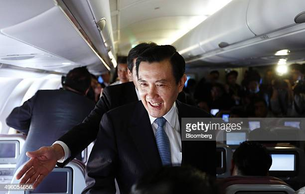 Ma Yingjeou Taiwan's president center greets members of the media traveling with him as he heads to Singapore for a summit on a chartered China...