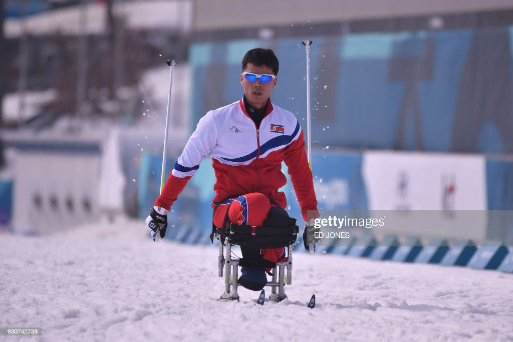 TOPSHOT - Ma Yu Chol of North Korea attends a cross-country training session at the Alpensia Biathlon Centre in Pyeongchang on March 12, 2018. / AFP PHOTO / Ed JONES