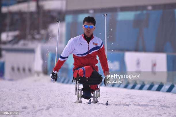 TOPSHOT Ma Yu Chol of North Korea attends a crosscountry training session at the Alpensia Biathlon Centre in Pyeongchang on March 12 2018 / AFP PHOTO...