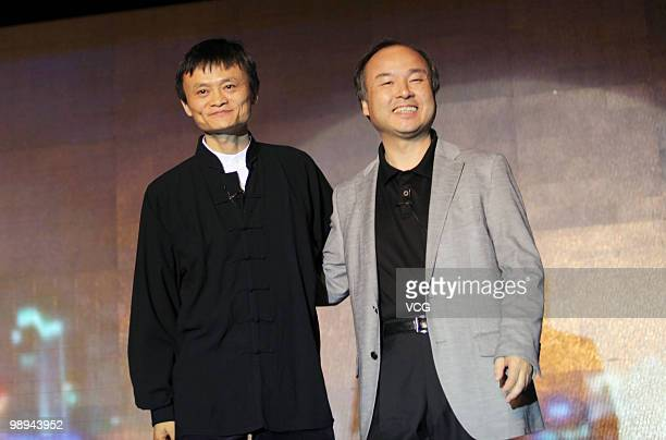 Ma Yun chairman of the Alibaba Group and Masayoshi Son Chairman and CEO of the Softbank Corportation pose for photos during the press conference on...