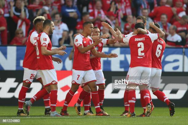 ma1^0 of Mainz celebrates the first goal during the Bundesliga match between 1 FSV Mainz 05 and Hamburger SV at Opel Arena on October 14 2017 in...