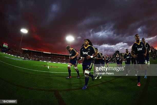 Ma'a Nonu and Hosea Gear of the Highlanders lead the team off prior to the round six Super Rugby match between the Chiefs and the Highlanders at...