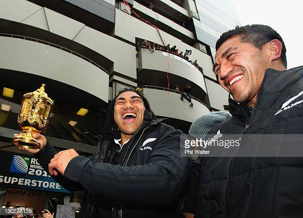 Ma'a Nonu and Mils Muliains All Blacks holds up the Webb Ellis Cup for the crowd during the New Zealand All Blacks 2011 IRB Rugby World Cup...