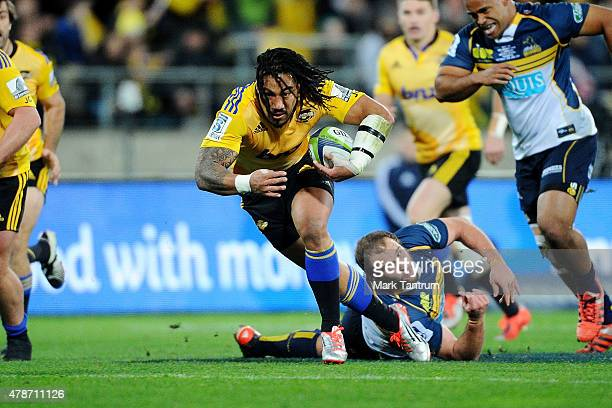 Ma'a Nonu breaks through a tackle during the Super Rugby Semi Final match between the Hurricanes and the Brumbies at Westpac Stadium on June 27 2015...