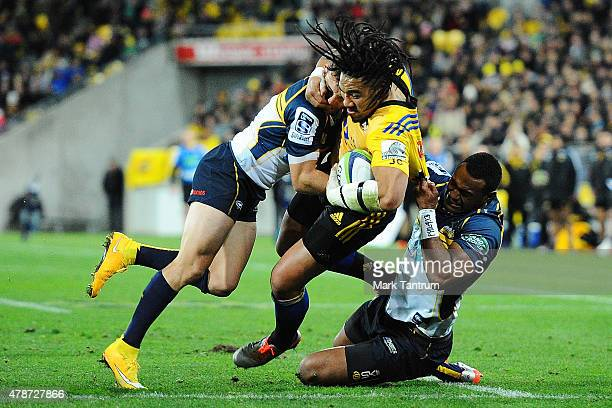 Ma'a Nonu is tackled during the Super Rugby Semi Final match between the Hurricanes and the Brumbies at Westpac Stadium on June 27 2015 in Wellington...