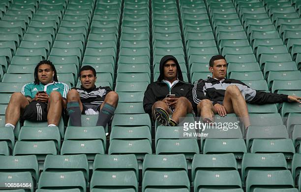 Ma'a Nonu Mils Muliaina Jerome Kaino and Sonny Bill Williams of the All Blacks listen to music in the stands during the New Zealand All Blacks...