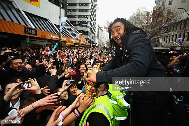 Ma'a Nonu of the All Blacks holds out the Webb Ellis Cup for the crowd during the New Zealand All Blacks 2011 IRB Rugby World Cup celebration parade...