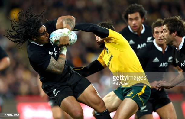 Ma'a Nonu of the All Blacks is tackled by Adam AshleyCooper of Australia during The Rugby Championship Bledisloe Cup match between the New Zealand...