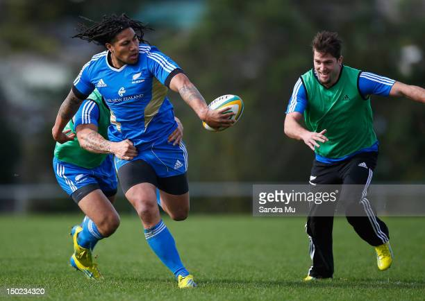 Ma'a Nonu of the All Blacks passes to Cory Jane of the All Blacks during a New Zealand All Blacks training session at Trusts Stadium on August 13...