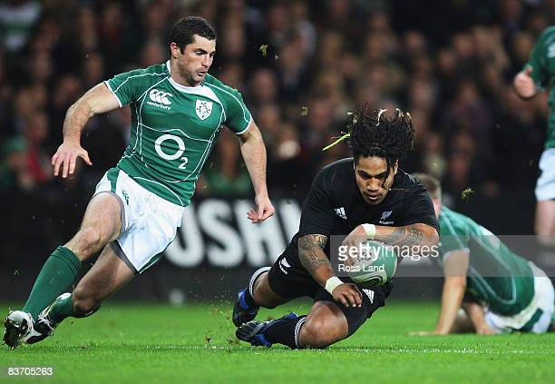Ma'a Nonu of the All Blacks scores a try as Robert Kearney looks on during the Guinness Series match between Ireland and New Zealand at Croke Park on...