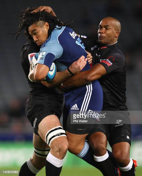 Ma'a Nonu of the Blues is tackled by JP Pietersen of the Sharks during the round eight Super Rugby match between the Blues and the Sharks at Eden...