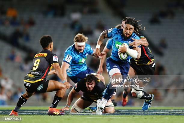 Ma'a Nonu of the Blues makes a run against Eben Etzebeth of the Stormers during the round 7 Super Rugby match between the Blues and the Stormers at...