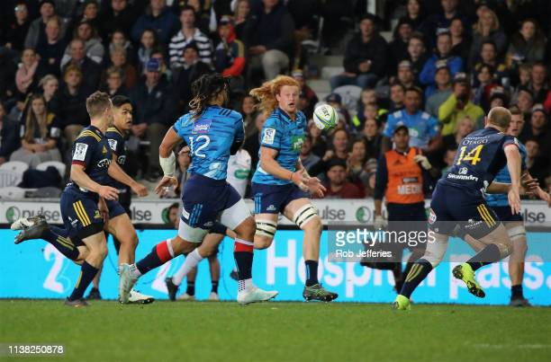 Ma'a Nonu of the Blues releases Tom Robinson of the Blues during the round 10 Super Rugby match between the Highlanders and the Blues at Forsyth Barr...