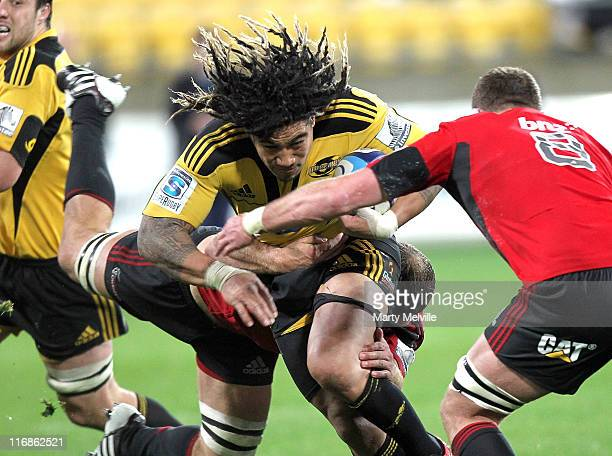 Ma'a Nonu of the Hurricanes is tackled by George Whitelock and captain Kieran Read of the Crusaders during the round 18 Super Rugby match between the...