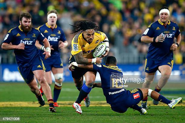 Ma'a Nonu of the Hurricanes is tackled by Lima Sopoaga of the Highlanders during the Super Rugby Final match between the Hurricanes and the...