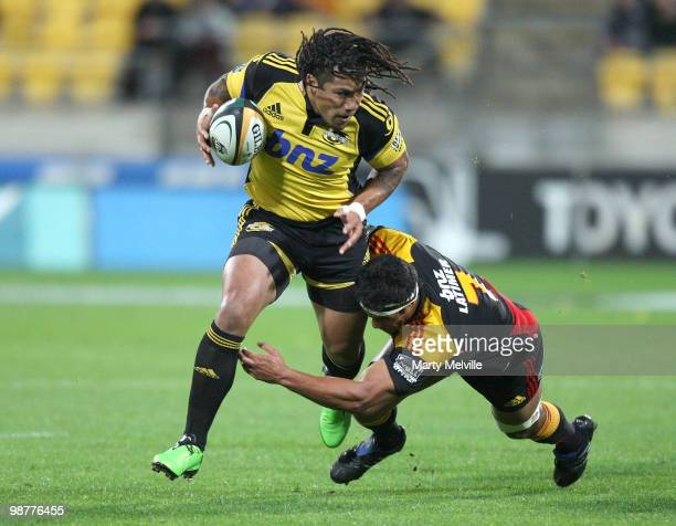 Ma'a Nonu of the Hurricanes is tackled by Tanerau Latimer of the Chiefs during the round 12 Super 14 match between the Hurricanes and the Chiefs at...