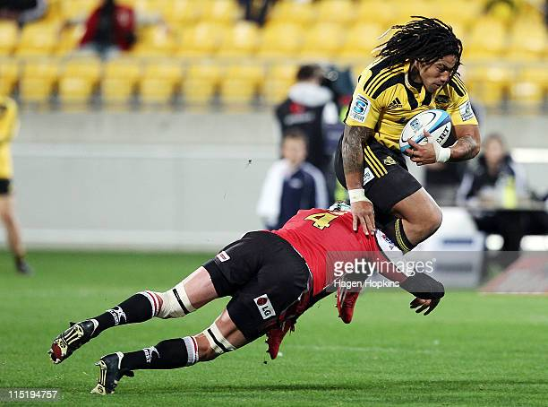 Ma'a Nonu of the Hurricanes is tackled Wikus van Heerden of the Lions during the round 16 Super Rugby match between the Hurricanes and the Lions at...