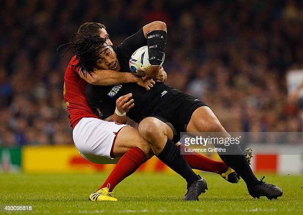 Ma'a Nonu of the New Zealand All Blacks is tackled by Remi Tales of France during the 2015 Rugby World Cup Quarter Final match between New Zealand...