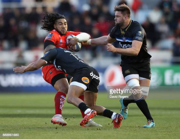 Ma'a Nonu of Toulon is tackled by Jonathan Joseph and Elliot Stooke during the European Rugby Champions Cup match between RC Toulon and Bath Rugby at...