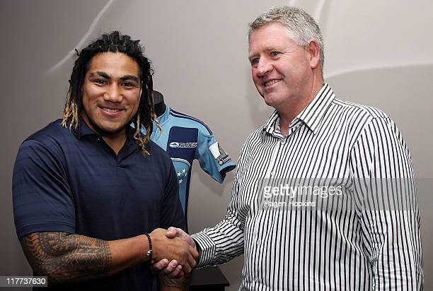 Ma'a Nonu shakes hands with CEO of the New Zealand Rugby Union, Steve Tew, at the New Zealand Rugby Union offices on July 1, 2011 in Wellington, New...