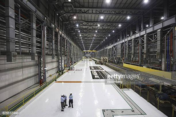 Ma'aden workers stand inside the aluminium rolling mill at the Ras Al Khair Industrial City operated by the Saudi Arabian Mining Co in Ras Al Khair...