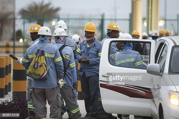 Ma'aden workers wait for transport at the aluminium processing plant at the Ras Al Khair Industrial City operated by the Saudi Arabian Mining Co in...
