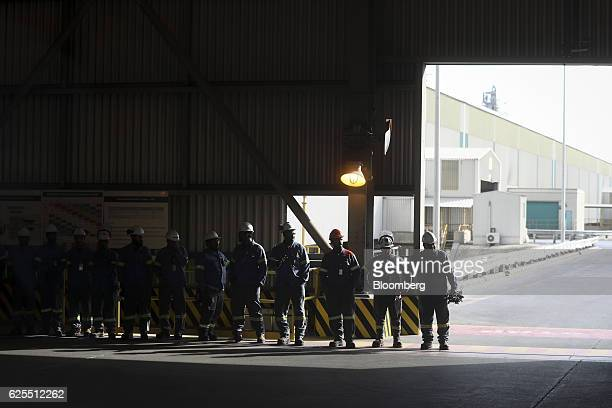 Ma'aden workers wait to meet the media during a press tour of the aluminium processing plant at the Ras Al Khair Industrial City operated by the...