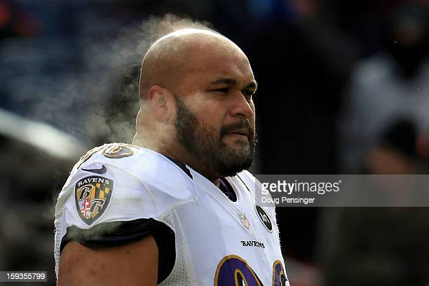 Ma'ake Kemoeatu of the Baltimore Ravens looks on during warm ups against the Denver Broncos during the AFC Divisional Playoff Game at Sports...