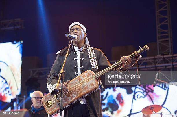 Maalem Hassan Boussou performs on the stage during 19th Annual Gnaoua Music Festival at Moulay Hassan square in Essaouira Morocco on May 14 2016