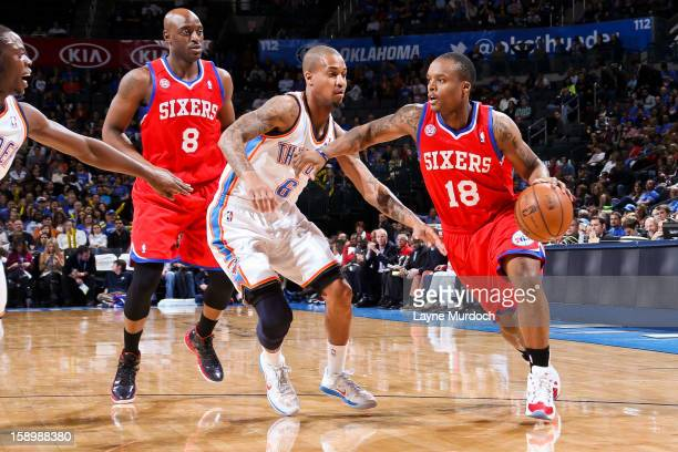 Maalik Wayns of the Philadelphia 76ers drives against Eric Maynor of the Oklahoma City Thunder on January 4 2013 at the Chesapeake Energy Arena in...