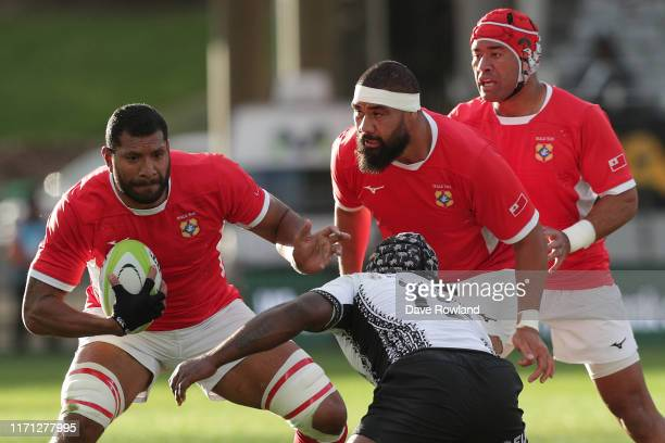 Maama Vaipulu of Tonga is challenged Levani Botia of Fiji during the International Friendly match between Fiji and Tonga at Eden Park on August 31,...