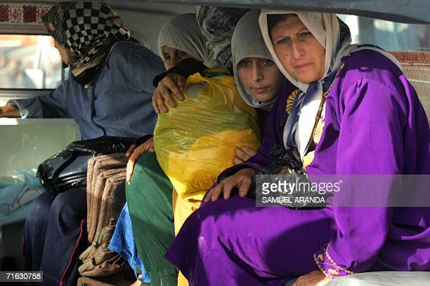 Lebanese women evacuated from the southern Lebanese village of Arson sit inside a Red Cross ambulance in Maaroub west of the port city of Tyre 11...