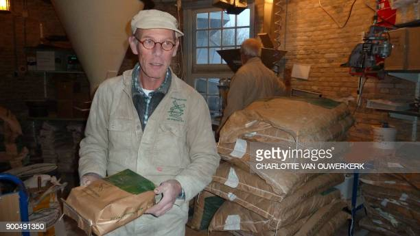 Maarten Dolman one of the last Dutch millers looks on at his mill in Ijsselstein in the province of Utrecht The Netherlands on December 14 2017 / AFP...