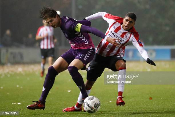 Maarten Peijnenburg of FC Utrecht U23 Laros Duarte of PSV U23 during the Dutch Jupiler League match between PSV U23 v Utrecht U23 at the De Herdgang...