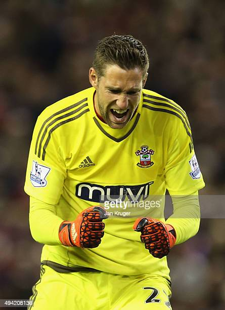 Maarten Stekelenburg of Southampton celebrates his team's first goal during the Barclays Premier League match between Liverpool and Southampton at...