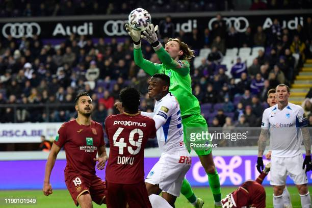 Maarten Vandevoordt goalkeeper of Genk Jhon Lucumi defender of Genk Nacer Chadli midfielder of Anderlecht and Jeremy Doku forward of Anderlecht fight...