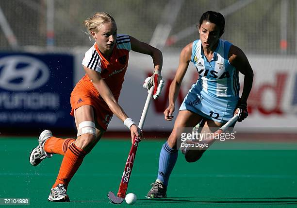 Maartje Goderie of the Netherlands is chased by Mariana Oliva Gonzalez of Argentine during the Netherlands v Argentina semifinal match in the Womens...