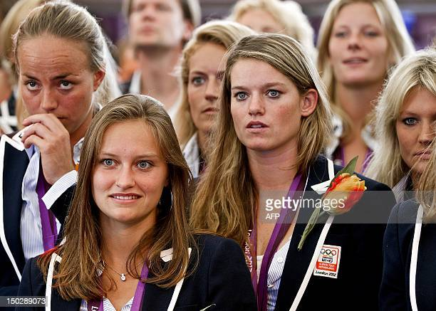 Maartje Paumen Kelly Jonker and Lidewij Welten of the Dutch women's hockey team watch a video of the 2012 London Olympic final match against...