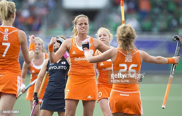 Maartje Paumen of the Netherlands reacts after scoring 30 during the Field Hockey World Cup 2014 match between Netherlands and Japan at the Kyocera...